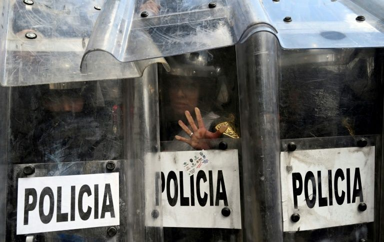Protestors-clash-with-shielded-Mexican-officers