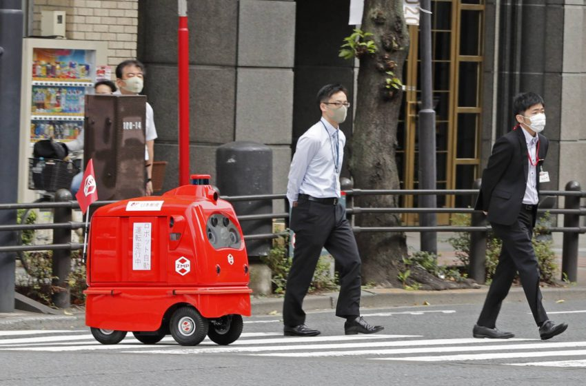 Japan's bright red 'post-box-on-wheels' takes a turn around Tokyo streets