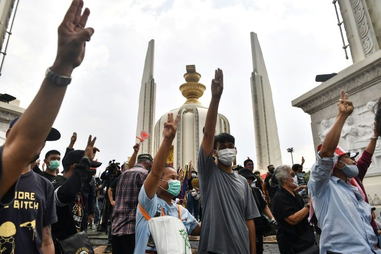 Three-fingered salutes raised to the skies, defiant Thai citizens call for equality