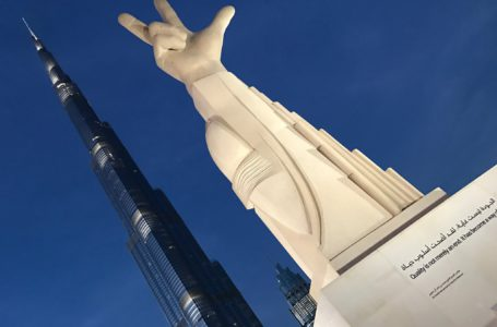 The 'three-fingered salute' statue in Downtown Dubai
