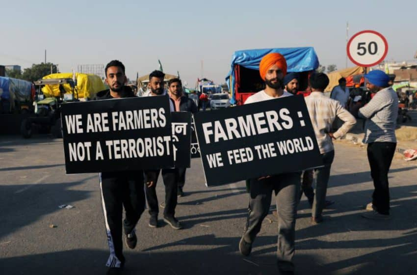 Tractor marches horde Indian streets as farmers demand agri law 'weeding'